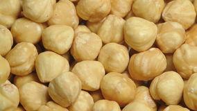shelled-hazelnut-pile-hazelnuts-slowly-rotating-34833912